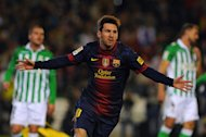 Lionel Messi celebrates after scoring during Barcelona's La Liga match against Real Betis on December 9. Messi insists that his record-breaking 86-goal haul in 2012 will count for nothing if Barcelona miss out on La Liga and Champions League titles