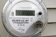 """A newly-installed """"smart"""" meter is seen on Thursday, May 10, 2012, in Burlington, Vt. Vermont has become a hotbed in the debate over possible health effects and damage to privacy from a new generation of """"smart"""" electric meters, wth lawmakers passing a measure to block utilities from charging customers for not having them. It's possible Vermont is the first state to not charge customers to """"opt-out.""""(AP Photo/Toby Talbot)"""