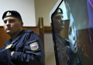 A policeman stands, as band member Nadezhda Tolokonnikova speaks on a TV screen in a hall outside a court room of the Moscow City Court where three members of the punk band Pussy Riot are set to make their case before a Russian appeals court that they should not be imprisoned, in Moscow, Wednesday. Oct. 10, 2012. Their impromptu performance inside Moscow&#39;s main cathedral in February came shortly before Putin was elected to a third term. The three women were convicted in August of hooliganism motivated by religious hatred and sentenced to two years in prison. (AP Photo/Sergey Ponomarev)