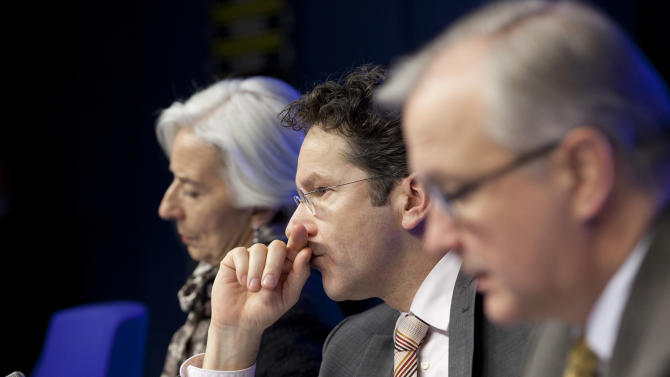 From left, Managing Director of the International Monetary Fund Christine Lagarde, Dutch Finance Minister and chief of the eurogroup Jeroen Dijsselbloem and EU Commissioner for Monetary Affairs Olli Rehn participate in a media conference after an emergency eurogroup meeting in Brussels on Monday, March 25, 2013. After failing for a week to find a solution at home to a crisis that could force it into bankruptcy, Cypriot politicians were turning to the European Union on Sunday in a last-ditch effort to help the island nation forge a viable plan to secure an international bailout. (AP Photo/Virginia Mayo)