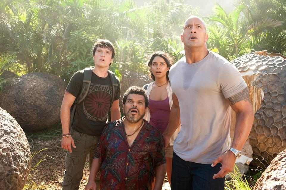 "In this image released by Warner Bros. Pictures, from left, Josh Hutcherson, Luis Guzman, Vanessa Hudgens and Dwayne Johnson are shown in a scene from ""Journey 2: The Mysterious Island."" (AP Photo/Warner Bros. Pictures, Ron Phillips)"