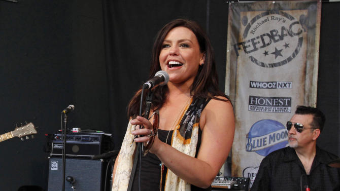 FILE - This March 19, 2011 file photo shows Rachael Ray introducing a band at her Feedback side party during the SXSW Music Festival in Austin, Texas. The author and Emmy-winning chef is getting ready for next month's South by Southwest Festival in Austin, Texas, where she again will be hosting all-day music performances, with more than a dozen bands. One of those bands, The Cringe, is led by her husband, John Cusimano. (AP Photo/Jack Plunkett, file)