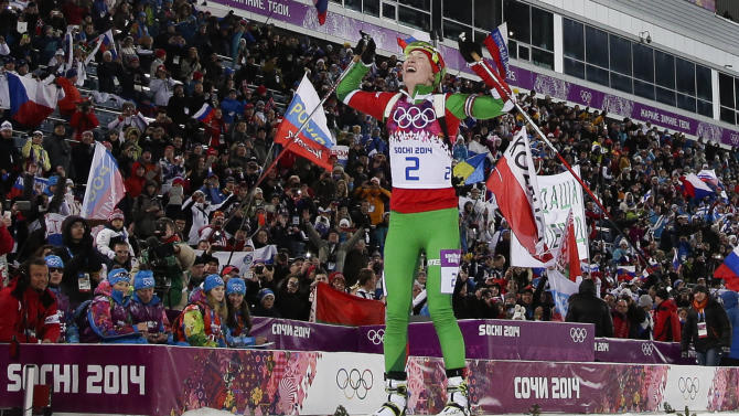 Belarus' Darya Domracheva celebrates winning the gold medal in the women's biathlon 12.5k mass-start, at the 2014 Winter Olympics, Monday, Feb. 17, 2014, in Krasnaya Polyana, Russia. (AP Photo/Felipe Dana)