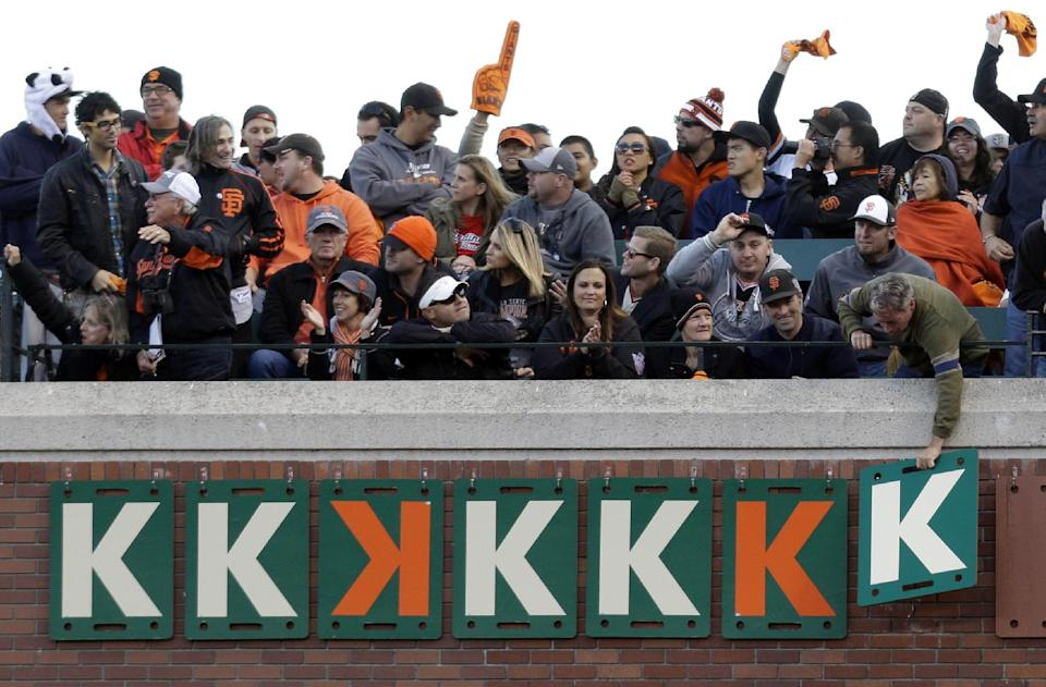 "Fans add a ""K"" after a San Francisco Giants starting pitcher Ryan Vogelsong strikeout during the fourth inning of Game 6 of baseball's National League championship series against the St. Louis Cardinals Sunday, Oct. 21, 2012, in San Francisco. (AP Photo/Ben Margot)"
