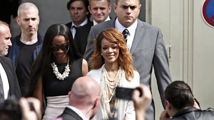 Singer Rihanna, centre, leaves after attending Chanel's Haute Couture Fall-Winter 2013-2014 collection, presented Tuesday, July 2, 2013 in Paris. (AP Photo/Thibault Camus)