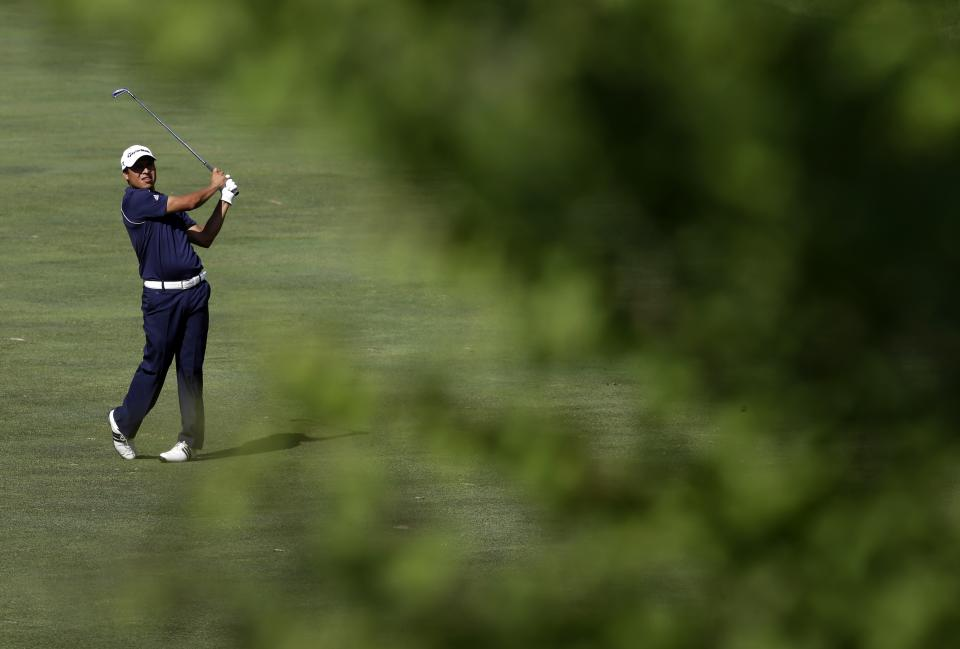 Andres Romero, of Argentina, is seen past a tree as he watches his hit on the 14th fairway during the third round of the AT&T National golf tournament at Congressional Country Club, Saturday, June 29, 2013, in Bethesda, Md. (AP Photo/Patrick Semansky)