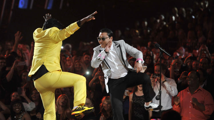 "Tracy Morgan, left, and Psy participate in a ""dance-off"" at the Billboard Music Awards at the MGM Grand Garden Arena on Sunday, May 19, 2013 in Las Vegas. (Photo by Chris Pizzello/Invision/AP)"