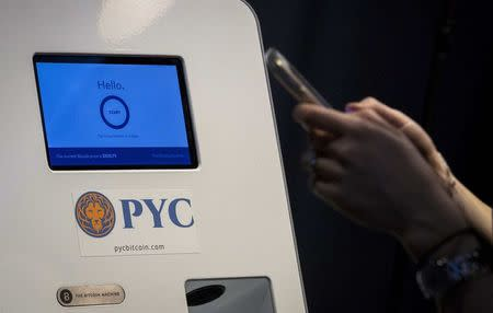 A customer prepares to use a Bitcoin ATM located in Flat 128, a boutique in New York's West Village