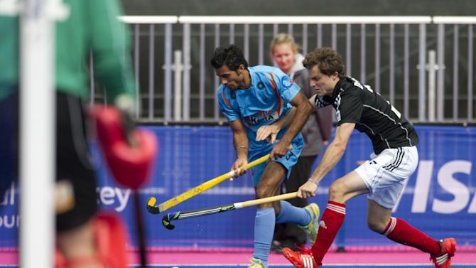 """India's Gurbaj Singh (L) vies with Germany's Oskar Deecke during their International Invitational Hockey Tournament match, part of the """"London Prepares"""" series of test events, at the Riverbank Arena at the Olympic Park in London on May 5, 2012. AFP PHOTO / MIGUEL MEDINAMIGUEL MEDINA/AFP/GettyImages"""