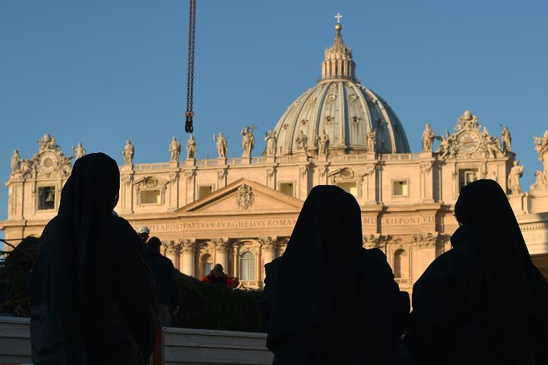 Nuns look on to St Peter's square at the Vatican on December 5, 2013