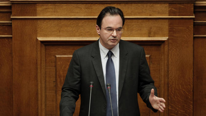Former finance minister Georges Papakonstantinou addresses to the Parliament in Athens on Thursday Jan. 17, 2013.  Greece's Parliament is debating whether to investigate four former senior members of the government including Papaconstantinou, over how leaked data on Greeks who banked in Switzerland was handled. All four deny wrongdoing. (AP Photo/Petros Giannakouris)