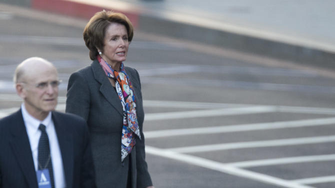 House Minority Leader Nancy Pelosi of Calif. waits for her car as she leaves a meeting at the White House in Washington, Friday, Dec. 28, 2012, after a closed-door meeting between President Barack Obama and Congressional leaders to negotiate the framework for a deal on the fiscal cliff.  The end game at hand, President Barack Obama and congressional leaders made a final stab at compromise Friday to prevent a toxic blend of middle-class tax increases and spending cuts from taking effect at the turn of the new year.  (AP Photo/ Evan Vucci)