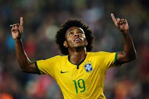 Brazil's forward Willian celebrates after scoring …