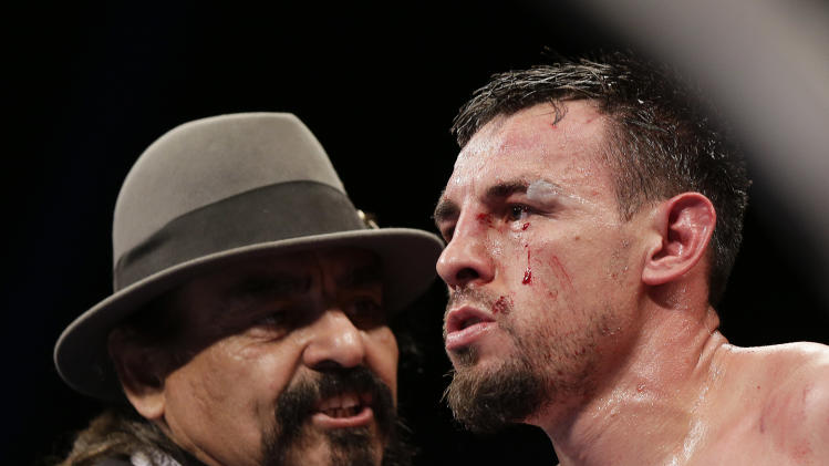 Robert Guerrero, right, listens to his father and trainer Ruben Guerrero as he sits in his corner after the ninth round against Floyd Mayweather Jr. during a WBC welterweight title fight, Saturday, May 4, 2013, in Las Vegas. (AP Photo/Isaac Brekken)