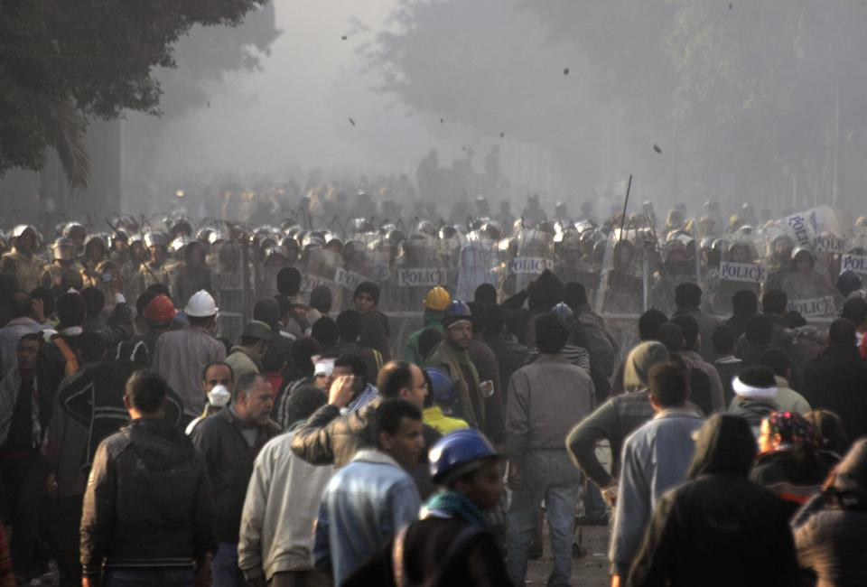 Egyptian protesters throw stones toward military police during clashes near Tahrir Square in Cairo, Egypt Saturday, Dec. 17, 2011. Egyptian soldiers clashed with hundreds of rock-throwing protesters in central Cairo for a second consecutive day on Saturday, in a resurgence of turmoil just days after millions voted in parliamentary elections. (AP Photo/Mohammed Abu Zaid)