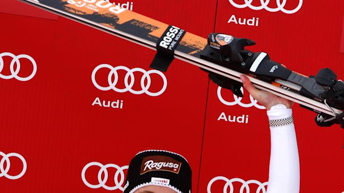 Switzerland's Lara Gut celebrates on the podium after winning a women's Alpine Ski World Cup downhill race, in Val d'Isere, France, Friday, Dec.14, 2012. (AP Photo/Pier Marco Tacca)