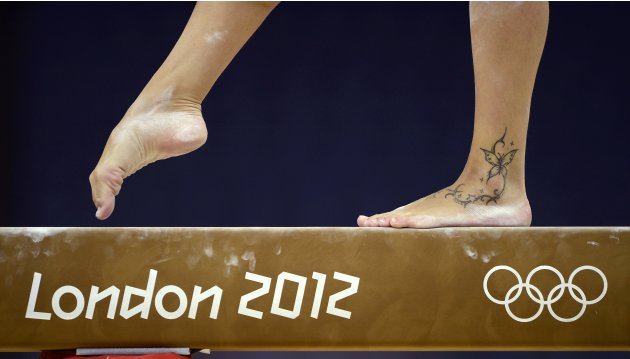 The butterfly tattoo of Vanessa Ferrari of Italy is seen as she attends a gymnastics training session at the O2 Arena before the start of the London 2012 Olympic Games