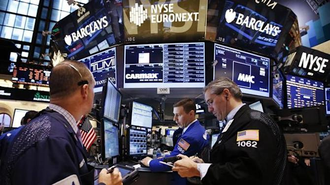 Traders work on the main trading floor of the New York Stock Exchange (NYSE) shortly after the opening bell in New York, May 20, 2013. REUTERS/Mike Segar/Files