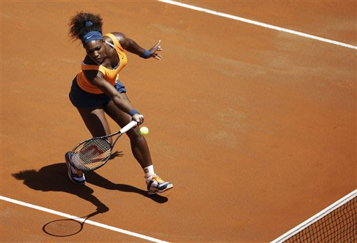 US Serena Williams returns the ball to Romania's Simona Halep during their semi final match at the Italian Open tennis tournament in Rome, Saturday, May 18, 2013. Williams won 6-3, 6-0