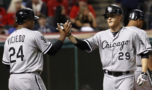 Johnson's 3 HRs lead White Sox past Indians 9-0