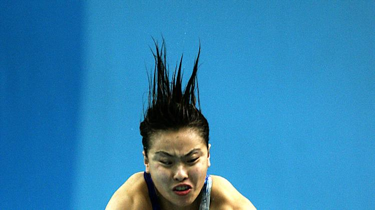 China's Minxia Wu dives in the preliminaries of the women's three metre springboard at the 2004 ...