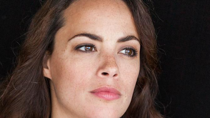 Actress Berenice Bejo poses for portraits at during the 66th international film festival, in Cannes, southern France, Saturday, May 18, 2013. (AP Photo/Laurent Emmanuel)