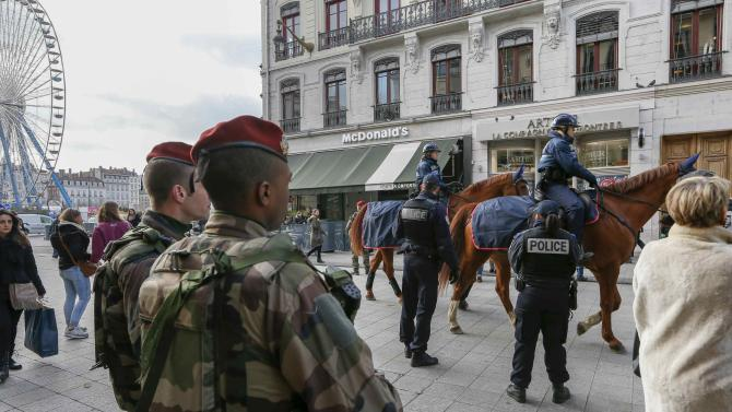 French paratroopers and mounted French police are seen in the center of Lyon as the security measures in public places is reinforced after recent deadly attacks in Paris
