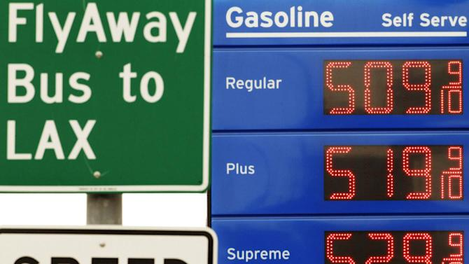 Gasoline prices above five-dollars a gallon are posted at a gas station in downtown Los Angeles on Friday, March 16, 2012. (AP Photo/Damian Dovarganes)