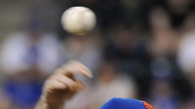 New York Mets pitcher R.A. Dickey delivers the ball to the Baltimore Orioles during the second inning of an interleague baseball game, Monday, June 18, 2012, at Citi Field in New York. (AP Photo/Bill Kostroun)
