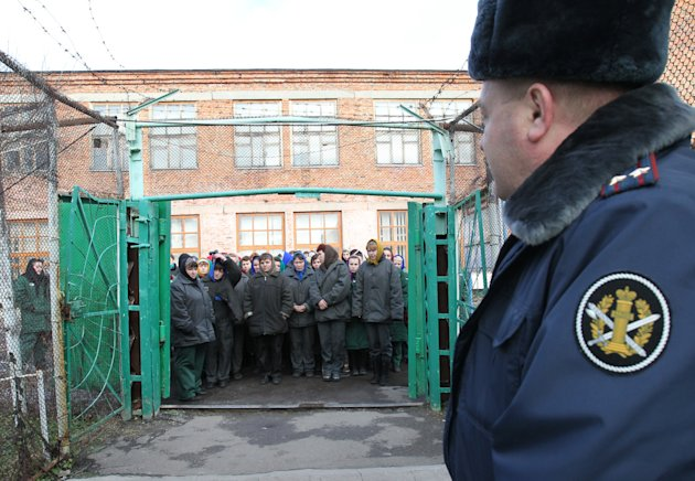 "In this photo taken Nov. 30, 2011, imprisoned women wait to be escorted for work at a women's prison outside the city of Orel, central Russia. Two members of the punk band Pussy Riot will serve their sentence in a penal colony far from Moscow that is like what a former inmate describes as a ""nasty Girl Scout camp."" Although Russia's prison system is a far cry from Stalin's gulag, the principle remains the same: to isolate people from their families and wear them down through ""corrective labor,"" which for women usually means hunching over a sewing machine. Maria Alyokhina and Nadezhda Tolokonnikova will have to quickly learn the inner laws of prison life, survive the dire food and medical care, and risk reprisal from inmates either offended by their ""punk prayer"" against President Vladimir Putin or ordered to pressure them by higher authorities. (AP Photo/Yuri Tutov)"