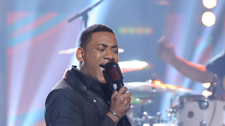 "In this April 25, 2012 photo released by Fox, contestant Josh Ledet performs on the singing competition series ""American Idol,"" in Los Angeles. (AP Photo/Fox, Michael Becker)"