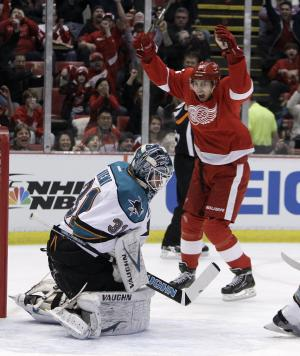 Detroit Red Wings center Valtteri Filppula (51), of Finland, celebrates teammate Henrik Zetterberg's goal against San Jose Sharks goalie Antti Niemi (31), also of Finland, during the first period of an NHL hockey game in Detroit, Sunday, Feb. 19, 2012. (AP Photo/Carlos Osorio)