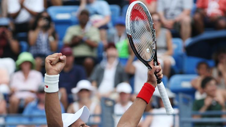 Novak Djokovic, of Serbia, reacts after defeating Philipp Kohlschreiber, of Germany, during the fourth round of the 2014 U.S. Open tennis tournament, Monday, Sept. 1, 2014, in New York. (AP Photo/John Minchillo)