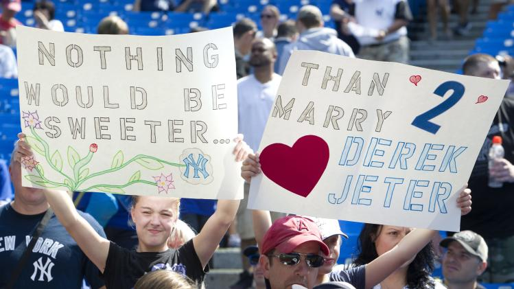 New York Yankees' Derek Jeter fans hold up signs at the Rogers Centre prior to the start of a baseball game between the Yankees and the Toronto Blue Jays in Toronto on Saturday, Aug. 30, 2014. This is Jeter's last visit to Toronto to play the Blue Jays before retiring at the end of the season. (AP Photo/The Canadian Press, Fred Thornhill)
