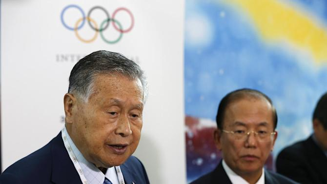 Tokyo 2020 Olympics President Yoshiro Mori, left, along with Tokyo 2020 Olympics CEO Toshiro Muto, talks to media after a presentation to the IOC committee in Kuala Lumpur, Malaysia, Wednesday, July 29, 2015. Malaysia is hosting the 128th International Olympic Committee executive board meeting where the vote for the host cities of the 2022 Olympic Winter Games and for the 2020 Youth Olympic Winter Games will take place. (AP Photo/Vincent Thian)
