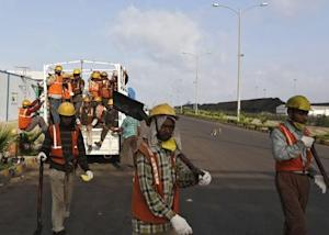 Workers arrive to work at Mundra Port Coal Terminal in the western Indian state of Gujarat