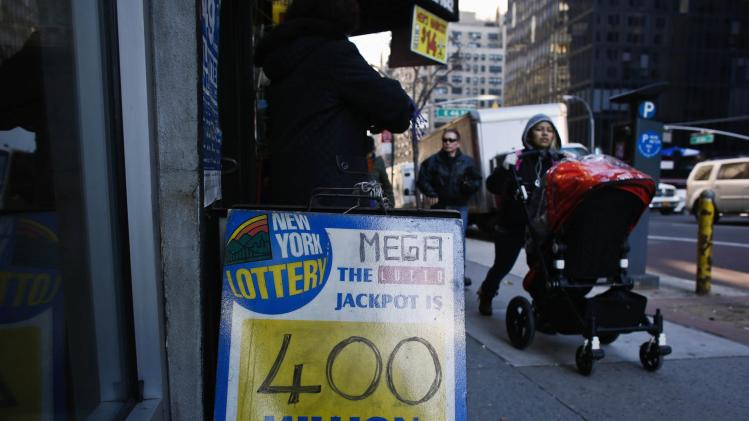 People walk next to a Mega Millions poster after the lottery grand prize rose to $400 million, in New York City