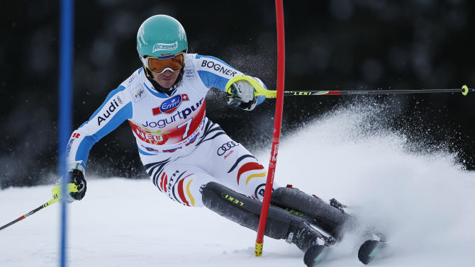 Felix Neureuther of Germany speeds down the course during the men's slalom for the finals of the Alpine skiing World Cup in Lenzerheide, Switzerland, Sunday,March.17,2013.(AP Photo/Shinichiro Tanaka)