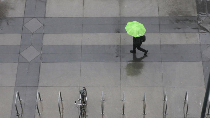 Umbrellas were called for as rain blanketed Sacramento, Calif, Monday, Oct. 22, 2012.  The first storm of the season swept through Northern California bringing rain to the lower elevations and snow in the mountains. (AP Photo/Rich Pedroncelli)