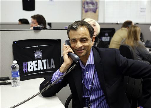 Vivek Ranadive, the new majority owner of the Sacramento Kings NBA basketball team smiles as a season ticket holder he called pledged to renew their seats, during a visit to the team's offices at Slee