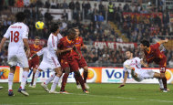 AS Roma's Nicolas Burdisso, of Argentina, right, scores during a Serie A soccer match against AC Milan, in Rome, Saturday, Oct. 29, 2011. (AP Photo/Alfredo Falcone, LaPresse) ITALY OUT