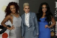 Pop group Stooshe arrive for the BRIT Awards, celebrating British pop music, at the O2 Arena in London February 20, 2013. REUTERS/Luke Macgregor