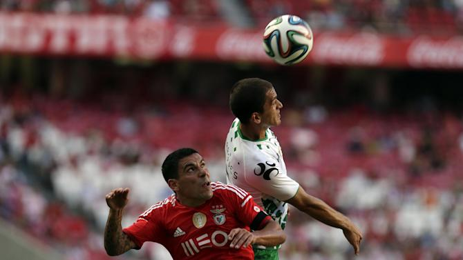 Benfica's Maxi Pereira, from Uruguay, tussles for a high  ball with Moreirense's Andre Marques, top, during a Portuguese league soccer match between Benfica and Moreirense at Benfica's Luz stadium, in Lisbon, Sunday, Sept. 21, 2014. Pereira scored once in Benfica's 3-1 victory