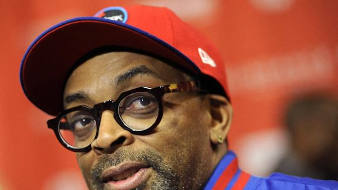 """FILE - This Jan. 22, 2012 file photo shows director Spike Lee at the premiere of the film """"""""Red Hook Summer"""" at the 2012 Sundance Film Festival in Park City, Utah. Lee is working on a documentary about Michael Jackson's """"Bad"""" album. Lee's documentary will be part a flood of material to celebrate the 25th anniversary of the """"Bad"""" album, Jackson's follow-up to """"Thriller"""" which included hits like the title track, """"Smooth Criminal,"""" """"The Way You Make Me Feel"""" and more.  The album is being re-released Sept.18 with additional tracks, a DVD and other bonus material; Lee's film is due to come out later this year, but no date has been set. (AP Photo/Chris Pizzello, file)"""