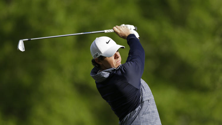 Rory McIlroy, of Northern Ireland, tees of on the 13th hole during the second round of the Wells Fargo Championship golf tournament at Quail Hollow Club in Charlotte, N.C., Friday, May 3, 2013. (AP Photo/Chuck Burton)