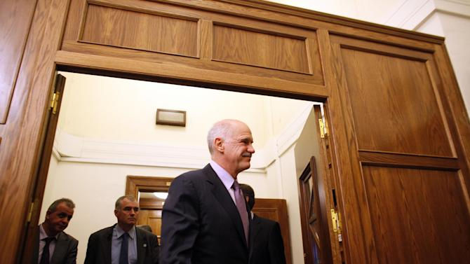 Greece's Prime Minister George Papandreou exits after a cabinet meeting at the parliament in Athens on Sunday, Nov. 6 2011. Greek leaders struggled for a second day to end an ongoing political crisis, under intense pressure to ensure the country doesn't go bankrupt in the next few weeks and that it remains in the eurozone. Papandreou informed cabinet members that he asked Greek President Karolos Papoulias for an urgent meeting with opposition leader Antonis Samaras. (AP Photo/Kostas Tsironis)