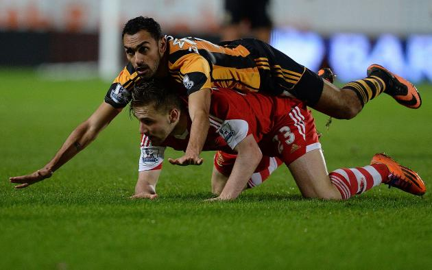 Hull City's Elmohamady challenges Southampton's Shaw during their English Premier League soccer match at the KC Stadium in Hull