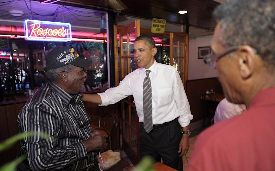 President Barack Obama greets patrons as he stops for a snack at Roscoe's House of Chicken and Waffles in Los Angeles, Monday, Oct. 24, 2011. Obama is on a three-day trip to the West Coast. (AP Photo/Susan Walsh)