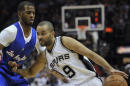 San Antonio Spurs guard Tony Parker, of France, drives around Los Angeles Clippers guard Chris Paul, left, during the first half an NBA basketball game, Monday, Dec. 22, 2014, in San Antonio. (AP Photo/Darren Abate)