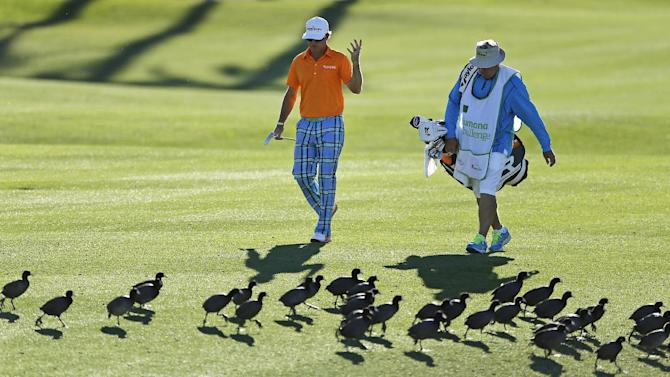 Brian Gay, left, gestures as he approaches the 18th green during the final round of the Humana Challenge PGA golf tournament on the Arnold Palmer Private Course at PGA West, Sunday, Jan. 20, 2013, in La Quinta, Calif. Gay won on the second hole of a playoff. (AP Photo/Ben Margot)